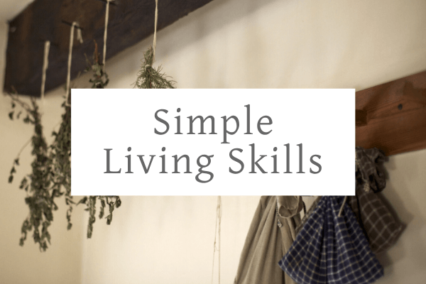 herbs hanging from the ceiling to dry representing simple living skills